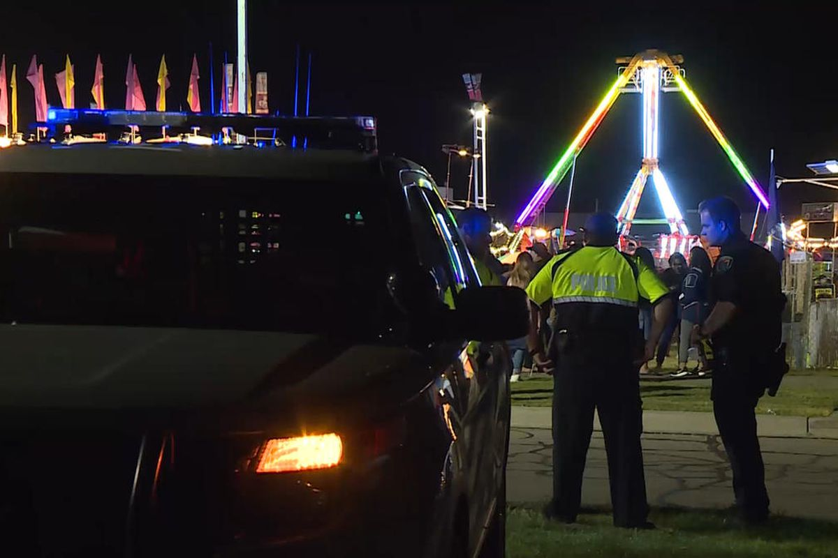 Police officers survey WestFest on June 16, 2017. Three men were hospitalized Friday after suffering stab wounds at the city's WestFest celebration.