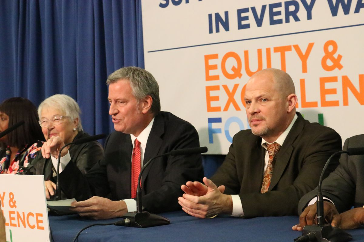 United Federation of Teachers President Michael Mulgrew, right, says the union is negotiating with Mayor Bill de Blasio, center, for a paid family leave policy.