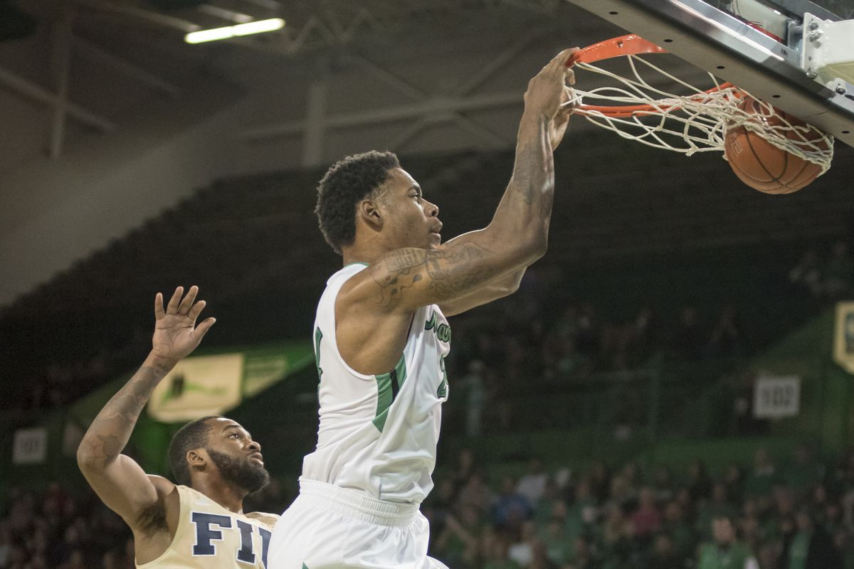 James Kelly (24) hammers home a dunk in Marshall's win over FIU.