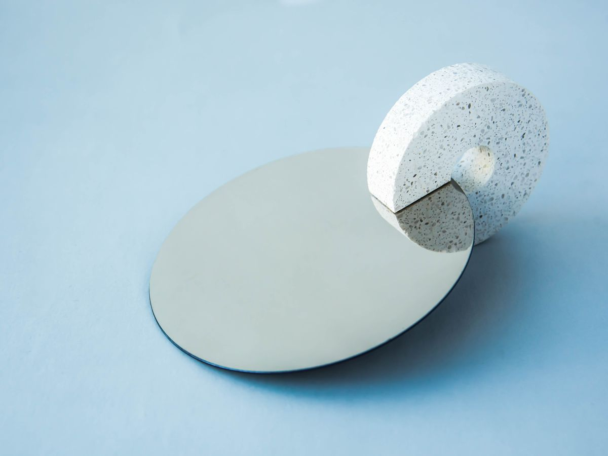 Hand mirror with stone handle