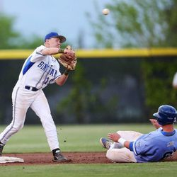 Bingham's Riley Akers tries to turn a double play as Pleasant Grove's Jade Smoot slides into second base as Bingham and Pleasant Grove play Wednesday, May 21, 2014 in a 5A one-loss bracket game at Kearns.