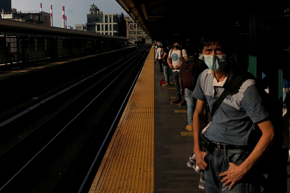 Riders wait for a 7 train at Queensboro Plaza, Aug. 27, 2020.