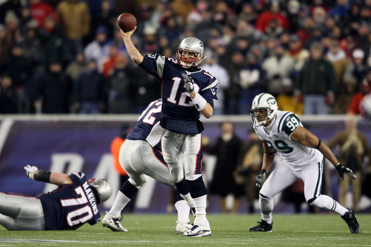 FOXBORO MA - DECEMBER 06:  Tom Brady #12 of the New England Patriots throws a pass in the first half against the New York Jets at Gillette Stadium on December 6 2010 in Foxboro Massachusetts.  (Photo by Elsa/Getty Images)