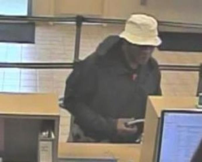 Surveillance image of the suspect in a bank robbery May 28 2019, at the BMO Harris Bank at 4050 147th St. in Midlothian.