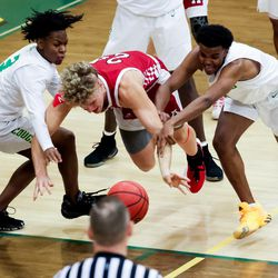 American Fork's Tobey Schmitt, center, comes under pressure from Kearns' Ivrson Lavizzo and Fuad Mowlid in a boys basketball game in Kearns on Friday, Jan. 8, 2021.