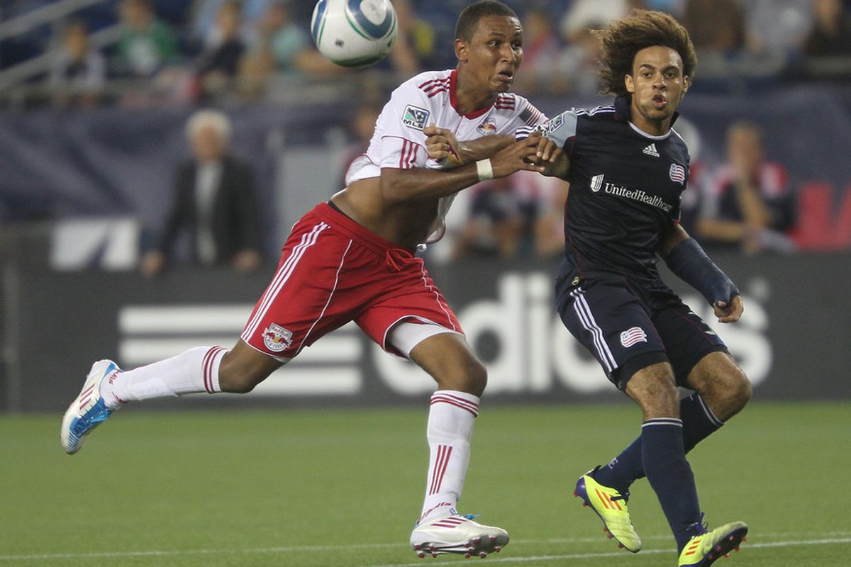 FOXBORO, MA - AUGUST 20: Juan Agudelo #17 of the New York Red Bulls battles Kevin Alston #30 of the New England Revolution at Gillette Stadium on August 20, 2011 in Foxboro, Massachusetts. (Photo by Jim Rogash/Getty Images)