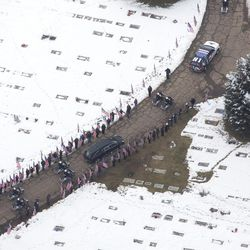 The funeral procession for Unified police officer Doug Barney arrives at the Orem City cemetery where Barney will be laid to rest alongside his father on Monday, Jan. 25, 2016. Officer Barney was shot and killed in the line of duty by a man who seemingly had done nothing more than leave the scene of a traffic accident Sunday, Jan. 17, 2016.
