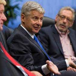 Libertarian presidential candidate Gary Johnson, center, and his running mate, Bill Weld, left, speak with the Deseret News and KSL editorial board in Salt Lake City on Friday, Aug. 19, 2016.