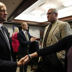 Evan McMullin, left, who's running running an independent bid for president, shakes hands with Deseret News reporter Lisa Riley Roche during a meeting with the Deseret News and KSL editorial board in Salt Lake City on Wednesday, Aug. 10, 2016.