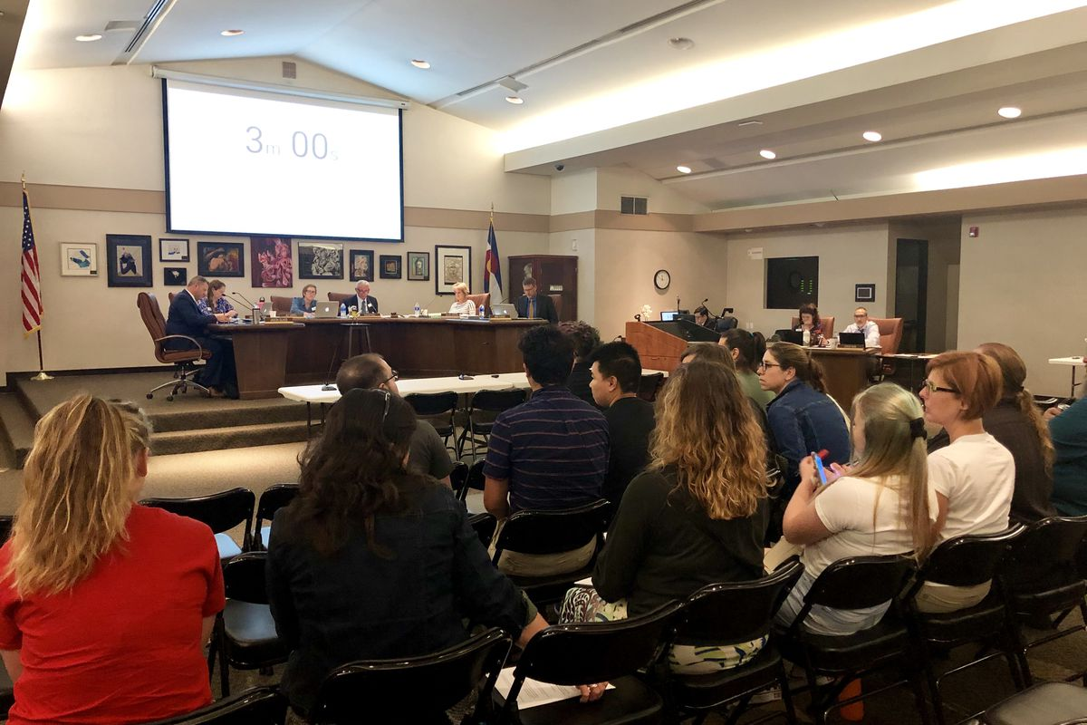 Some teachers, parents, and students wait to speak in favor of updating LGBTQ policies at the Jefferson County School Board meeting Thursday.
