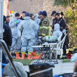 FILE - Police and DEA agents put on chemical suits as Local and federal agencies respond to a fentanyl drug bust in Cottonwood Heights on Tuesday, Nov. 22, 2016.