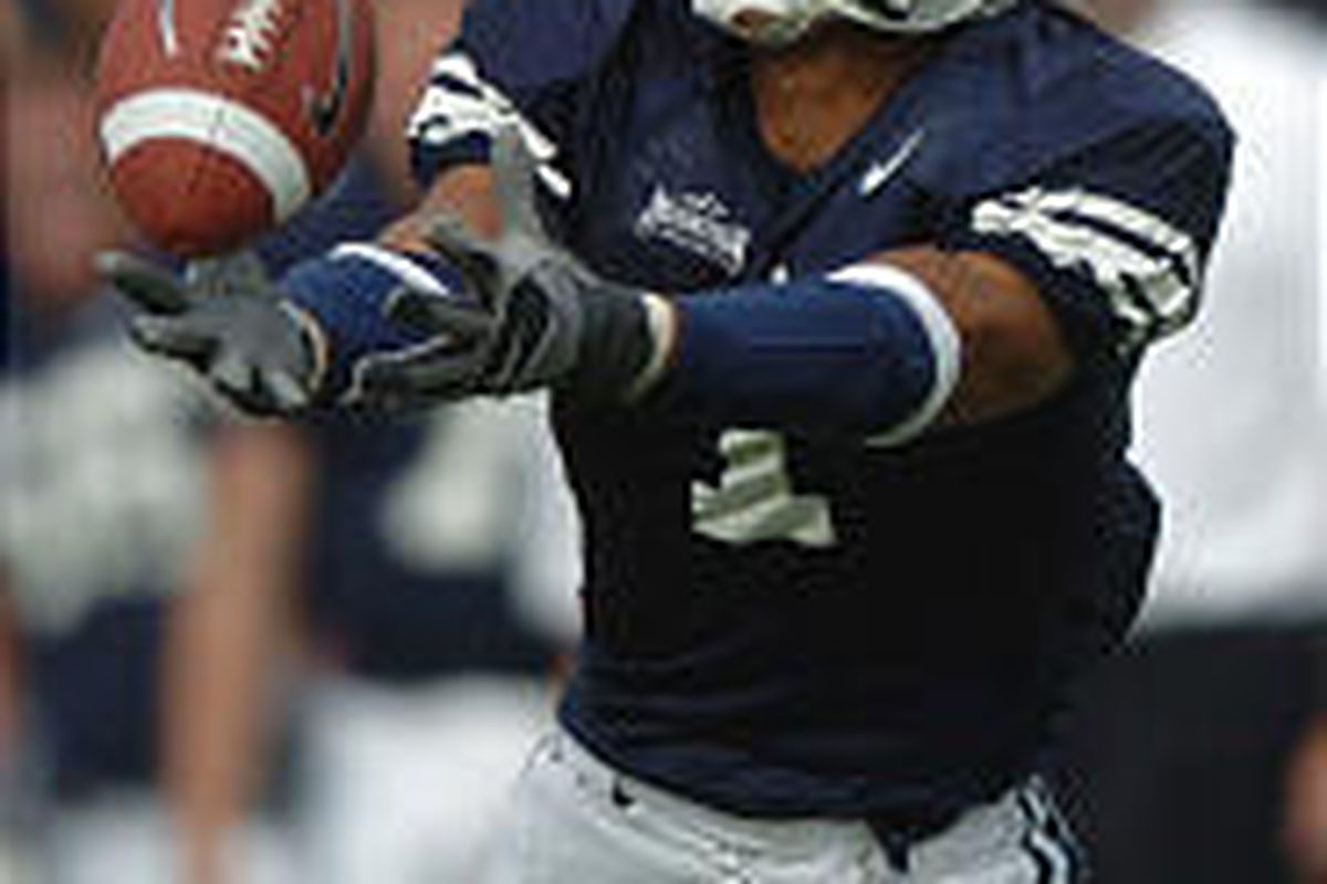 BYU wide receiver Todd Watkins makes a fingertip grab good for a touchdown against TCU. Cougar quarterback John Beck says the offense could have done even more damage against the Horned Frogs.