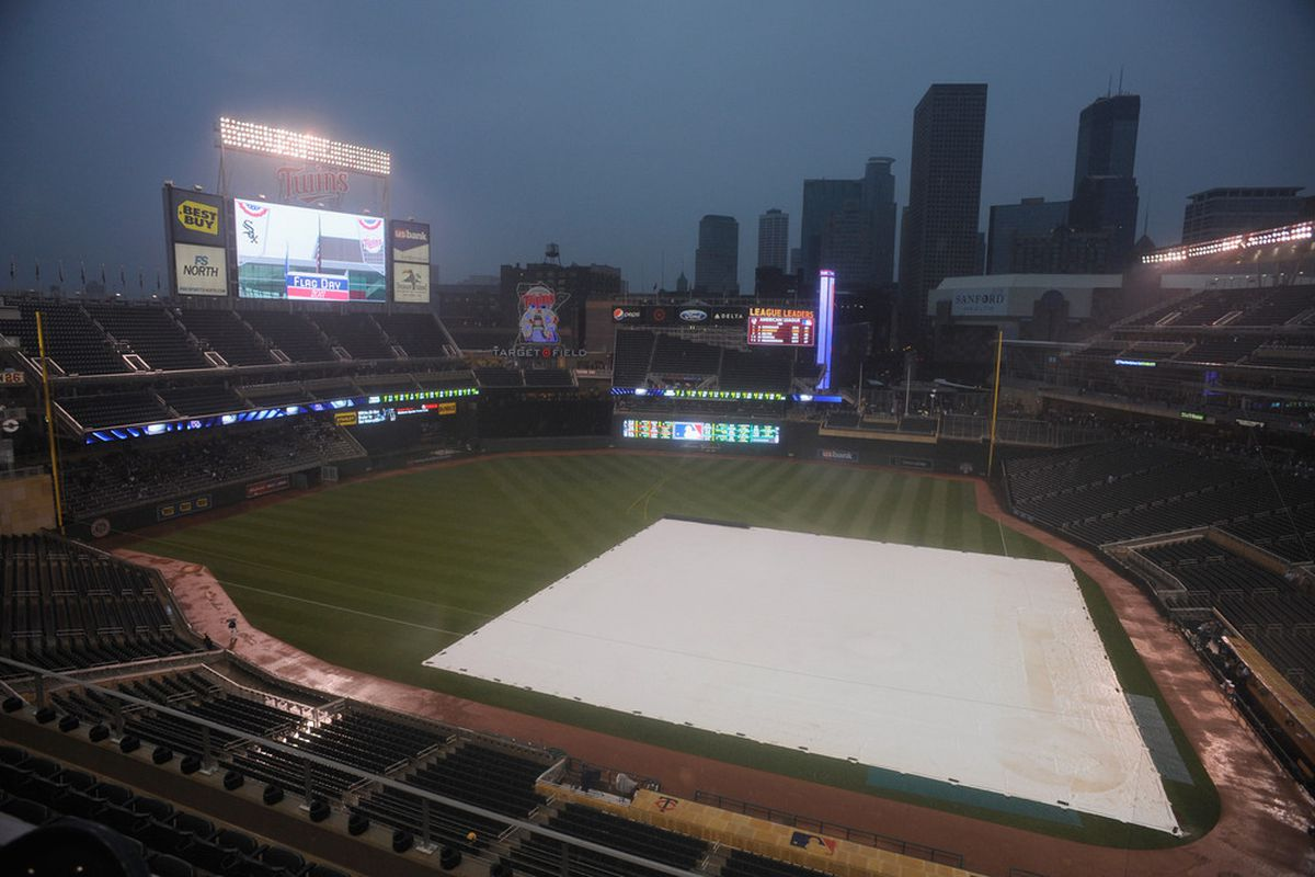MINNEAPOLIS, MN - JUNE 14: The field is covered as rain falls, delaying the start of the game between the Minnesota Twins and the Chicago White Sox on June 14, 2011 at Target Field in Minneapolis, Minnesota. (Photo by Hannah Foslien/Getty Images)