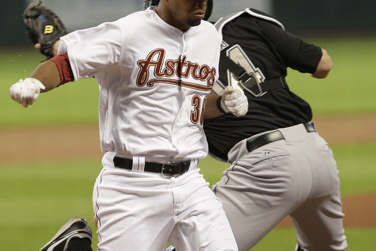 HOUSTON,TX- APRIL 9 : Angel Sanchez scores on Hunter Pence's RBI in the bottom of the first inning