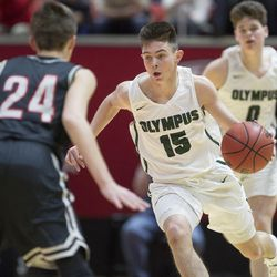 Olympus' Rylan Jones takes the ball to the basket during the Olympus Titans' 79-43 victory against the Bountiful Braves in the Class 5A state semifinals at the Jon M. Huntsman Center in Salt Lake City on Friday, March 2, 2018.