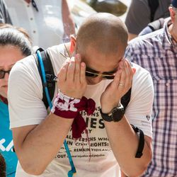 Brian Ozaki  prays with a consortium of Asian American groups brought together by the Japanese American Service Community to participate in the Families Belong Together march starting in Daley Plaza, Saturday, June 30th, 2018.   James Foster/For the Sun-Times