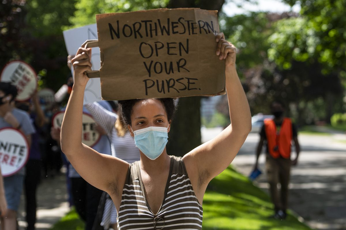 A few dozen Northwestern University staff march through Evanston demanding Northwestern University compensate them for wages they lost while the campus was closed amid the coronavirus pandemic, Wednesday, June 10, 2020.