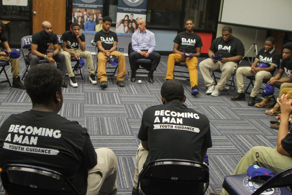 A circle is formed to kick off the Becoming A Man (BAM) meeting at Hyde Park Academy High School. It is a Youth Guidance Program at the school. Mayor Rahm Emanuel and Theo Epstein, President of Baseball Operations for the Chicago Cubs were present on Wedn