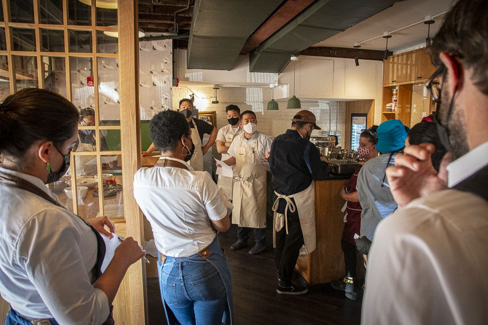 Anju owner Danny Lee addresses a group of chefs in the kitchen during an EmbraceRace dinner in April
