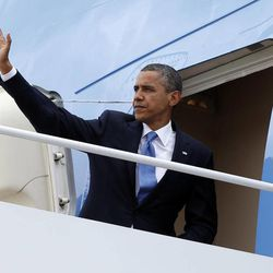 President Barack Obama boards Air Force One, Tuesday, Sept. 18, 2012, at Andrews Air Force Base, Md., en route to New York.