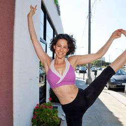 """<a href=""""http://la.racked.com/archives/2012/08/14/hottest_trainer_contestant_14_sara_ivanhoe.php"""">Sara Ivanhoe</a> of YogaWorks"""