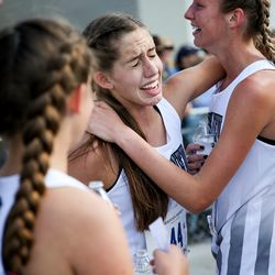 Pine View High's Jenessa Finch and Pyper Holt celebrate after they clinched the team title in the 4A Girls State Cross-Country Championships at Highland High School in Salt Lake City on Wednesday, Oct. 23, 2019.