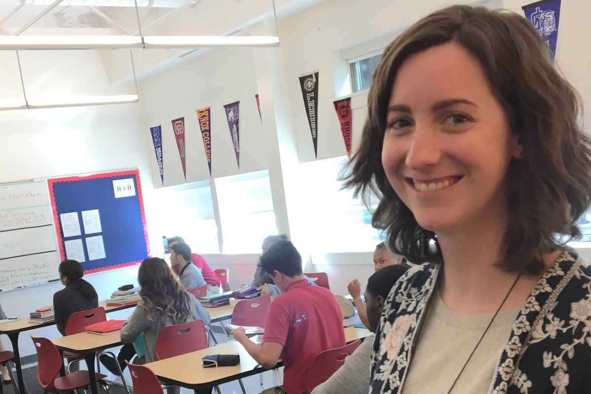 Sarah MacCallum, director of college counseling at Noble Academy on Chicago's Near North Side checks on students using the College Bot.