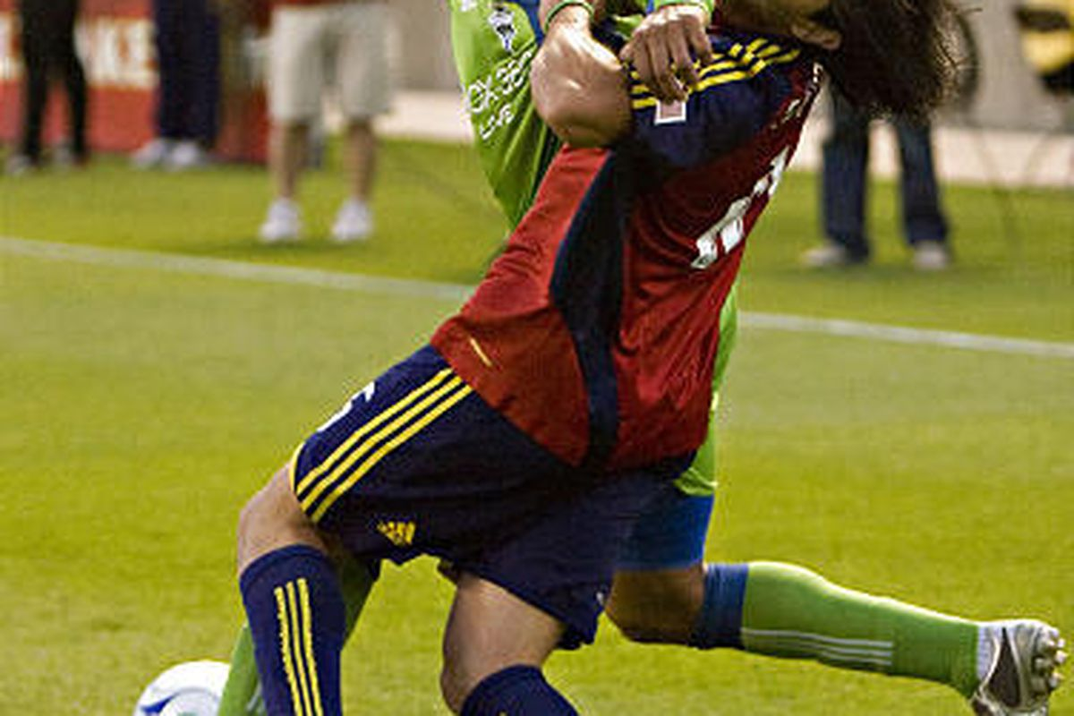 Real Salt Lake's Fabian Espindola gets an elbow to the jaw from Seattle Sounders' Fredy Montero in Saturday's game at Rio Tinto Stadium.