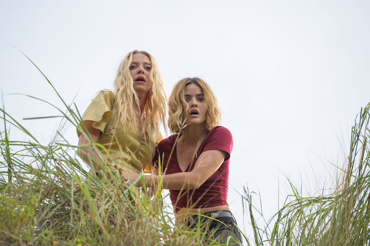 a woman and a young woman standing in tall grass look downward, scared, in Fantasy Island