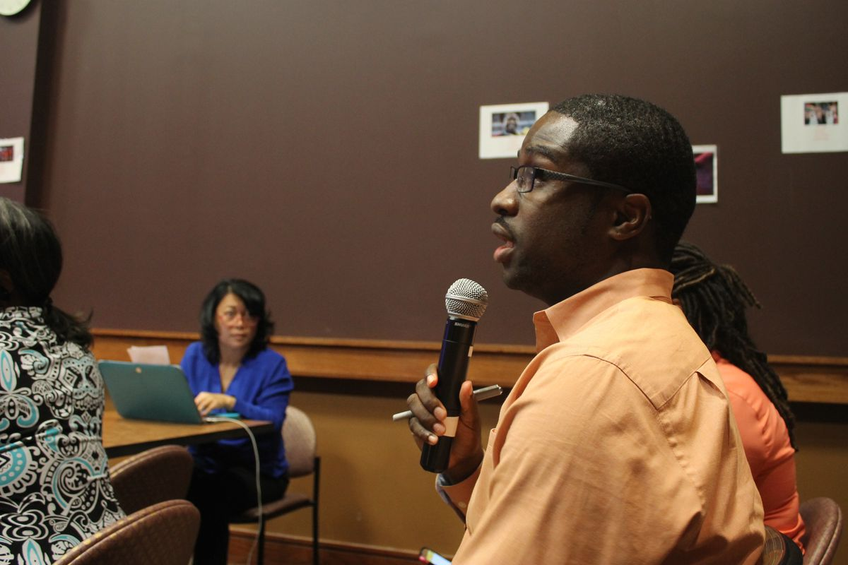 A teacher speaks at the Whitehaven community meeting.