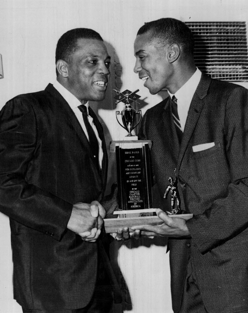 San Francisco's Willie Mays (left) was in town to present the Ken Hubbs Memorial Award to the ever popular Ernie Banks in 1965.   Sun-Times library