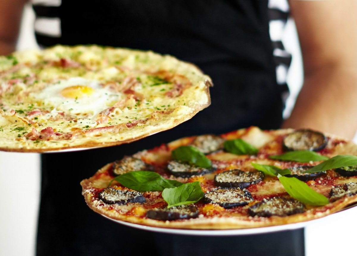 """Pizza Express restaurant in Oxford Circus has been redesigned to """"future-proof"""" the Italian restaurant chain"""