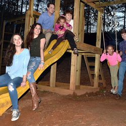 John, Kelly, Brailey, Brody, Gracie, Jace, Kolby and Cassie DeGarmo enjoy their playground equipment.