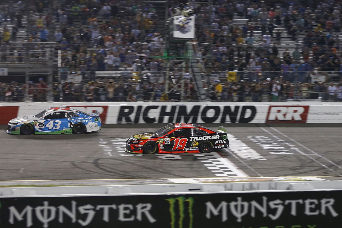 Monster Energy NASCAR Cup Series driver Martin Truex Jr. crosses the finish line to win the Federated Auto Parts 400 at Richmond International Raceway.