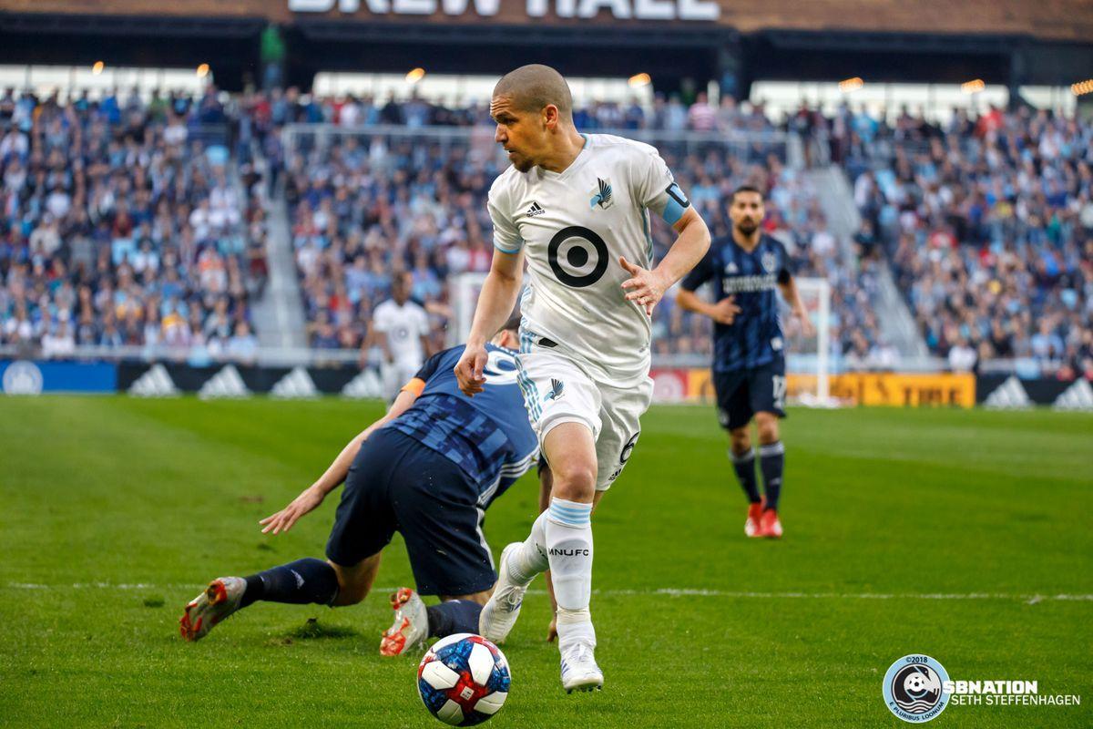 April 24, 2019 - Saint Paul, Minnesota, United States - Minnesota United midfielder Osvaldo Alonso (6) steals the ball from LA Galaxy forward Zlatan Ibrahimovic (9) during the match at Allianz Field.