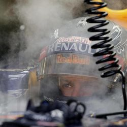 Red Bull Formula One driver Sebastian Vettel of Germany is surrounded by the vapour from dry ice as attempts to keep cool in his car during the first practice session for the Singapore Formula One Grand Prix on the Marina Bay City Circuit in Singapore, Friday, Sept. 21, 2012.