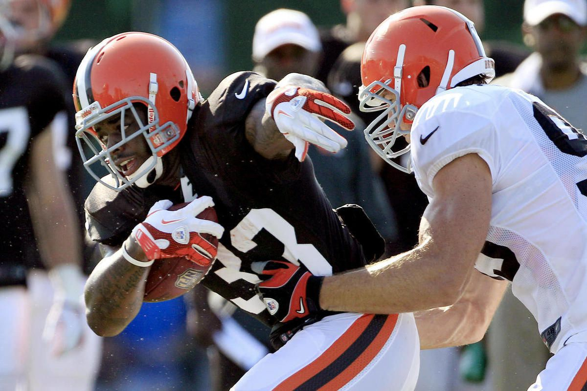FILE - In this July 29, 2012, file photo, Cleveland Browns running back Trent Richardson, left, tries to get past linebacker Scott Fujita during NFL football training camp  in Berea, Ohio. Coming off a dismal 4-12 season, their eighth in nine years of at