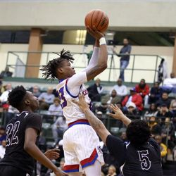 Curie's Ramean Hinton (23) shoots over the Orr defense in their CPS semi final game at Chicago State University, Friday, February 15, 2019. | Kevin Tanaka/For the Sun Times