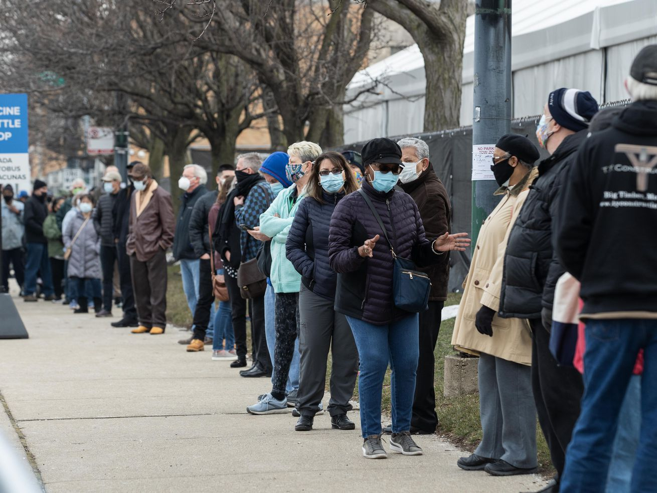 People lined up outside the COVID-19 vaccination site outside the United Center on March 9, the opening day for that mass vaccination site.