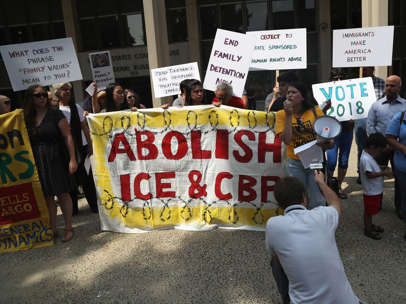Protesters rally against family separation at a US federal court in Connecticut.