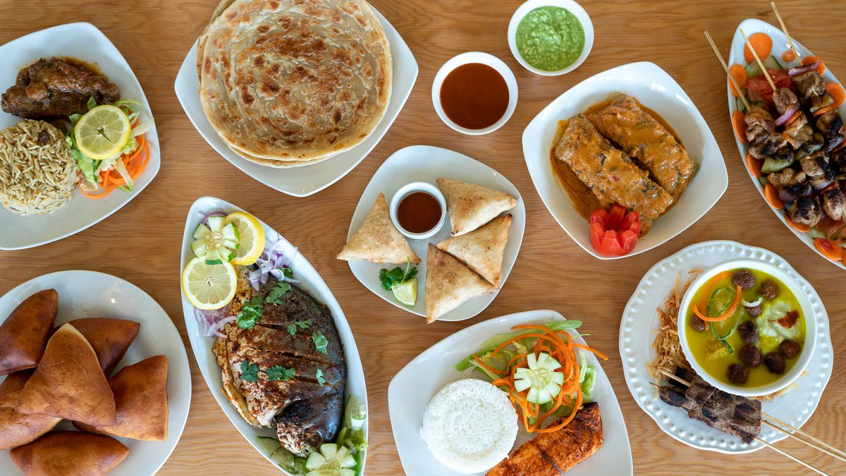 A top-down image of various dishes from Moyo Kitchen, which serves Somali-Kenyan-Tanzanian fusion food.