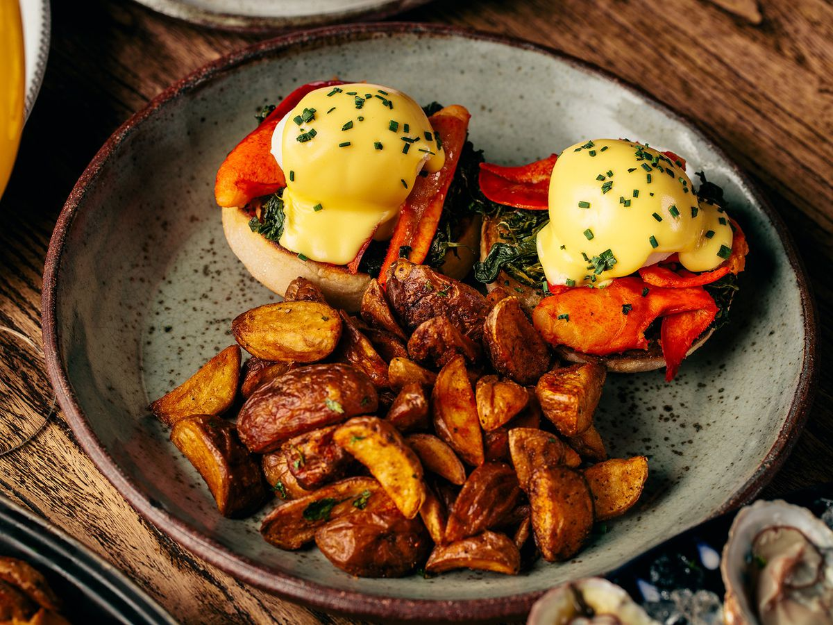 A lobster Benedict with potatoes