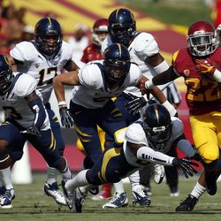 Southern California running back Curtis McNeal (22), right, runs with the ball during the first half of an NCAA college football game against California in Los Angeles, Saturday, Sept. 22, 2012.