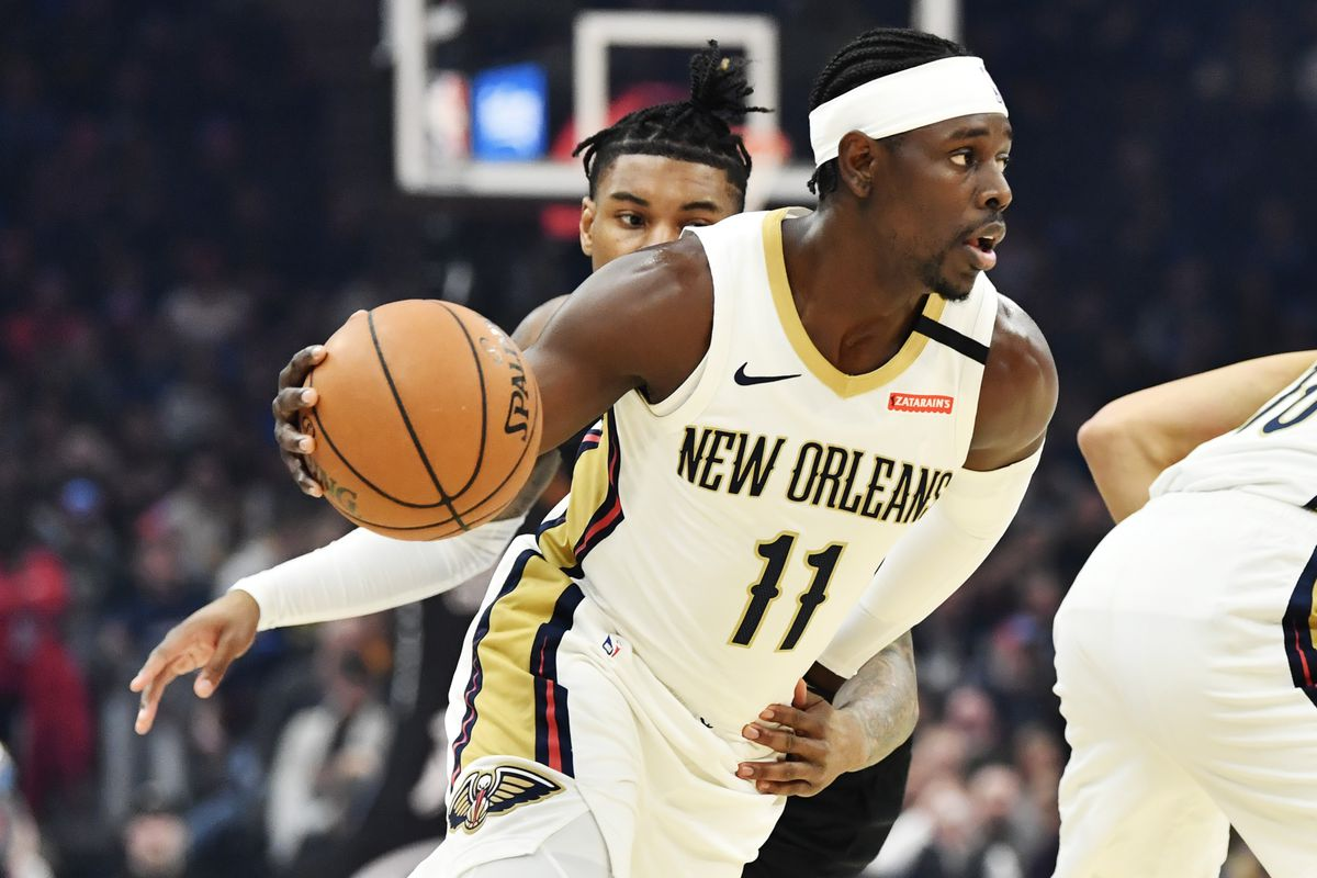 New Orleans Pelicans guard Jrue Holiday drives to the basket against Cleveland Cavaliers guard Kevin Porter Jr. during the first half at Rocket Mortgage FieldHouse.