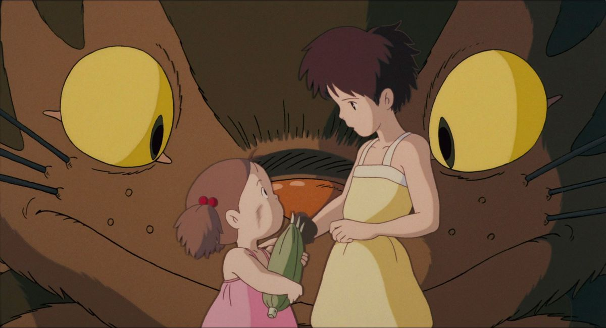 mei and satsuki reunite in front of the catbus face in my neighbor totoro