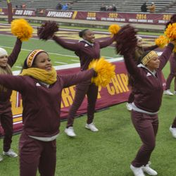 Central Michigan cheerleaders cheer during the fight song.