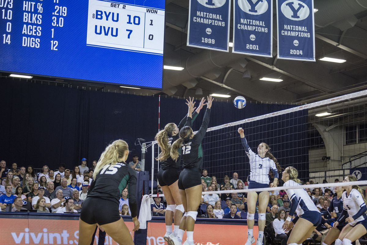 Utah Valley's Alexis Davies (front), Kristen Allred (left-center) and Jasmine Niutupuivaha (center) await an attack attempt from BYU's Madi Robinson (right-center) during Saturday afternoon's exhibition contest at BYU's Smith Fieldhouse.
