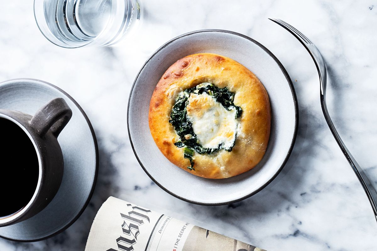 A kale and burrata danish with farm egg from Lyle's