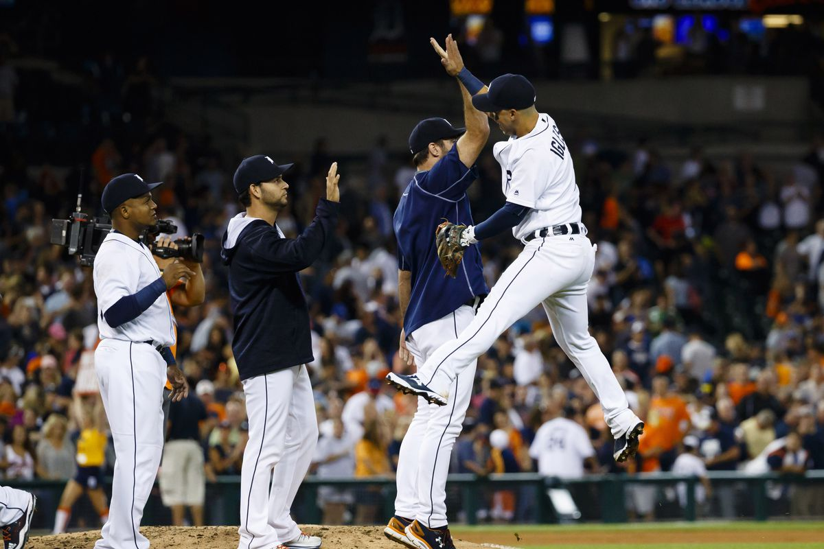 Tigers players celebrate after their Friday night victory over the Orioles.