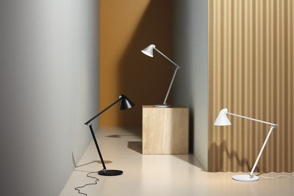 Black and white lamps with round bases and bent arms.